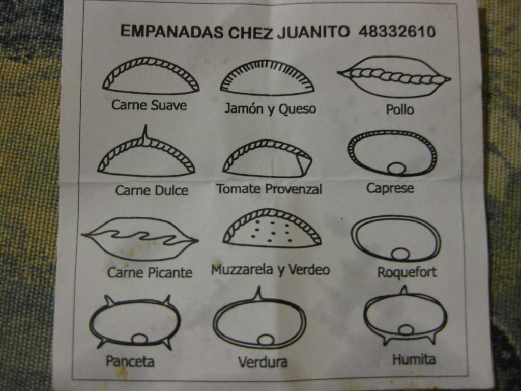 Was ist jeweils in der Empanada(Teigtasche) drin. Die Form verrät es. Auch in Argentinien - wie zum Beispiel hier bei Juanito in Buenos Aires - sollte man mal eine Empanada probieren